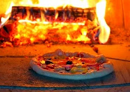 Pizzas Cook in Two Minutes in our Wood Fired Oven